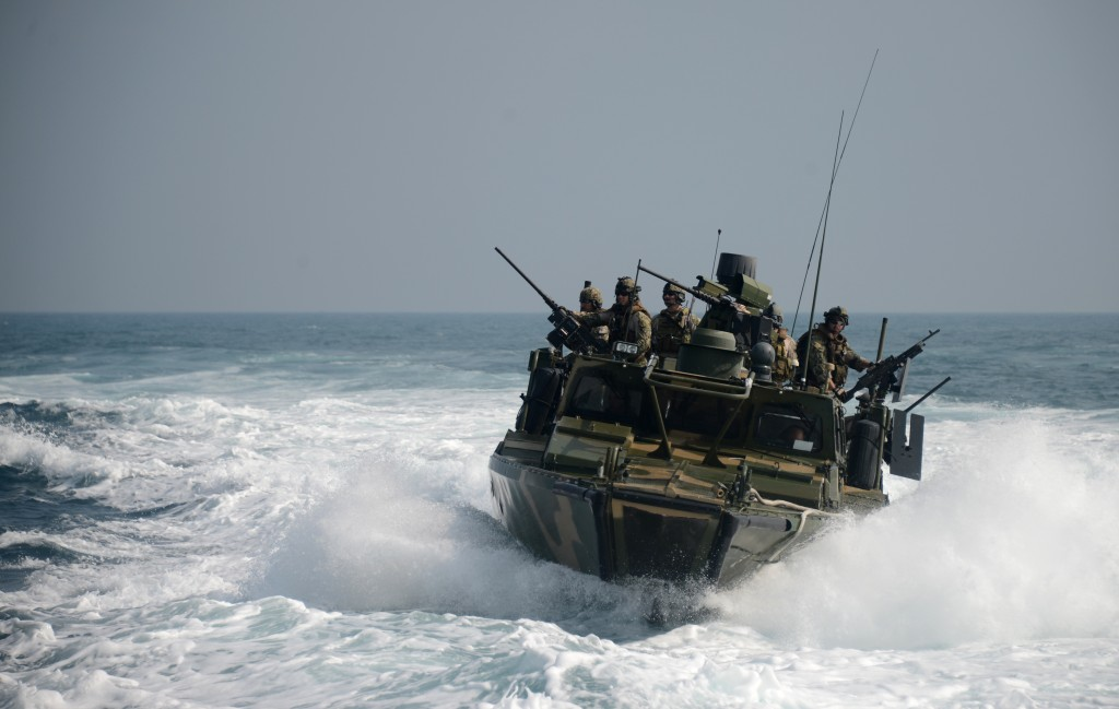 Task Group 56.7.4 aboard a riverine command boat during a training exercise.